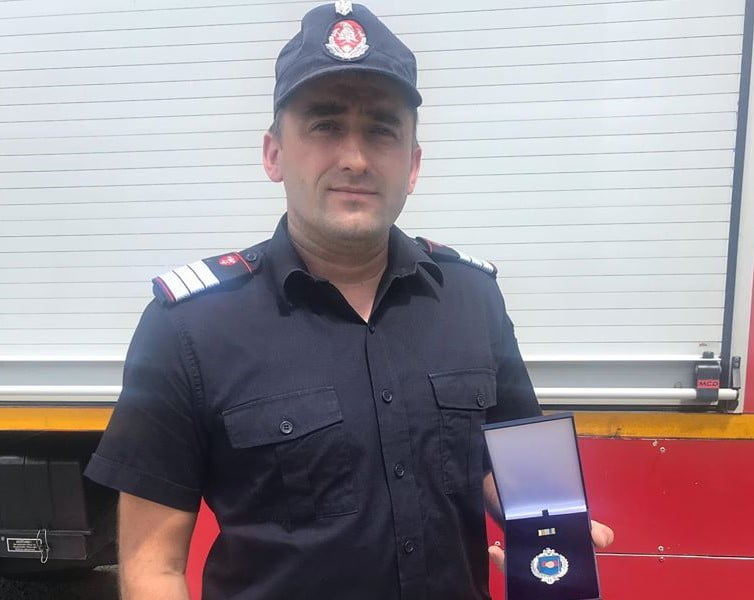 FOTO: Emblema de merit pentru un pompier din Sîngeorz Băi